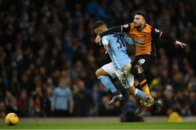 Hull City's midfielder Robert Snodgrass (R) vies with Manchester City's defender Nicolas Otamendi (L) during the English League Cup quarter-final football match in Manchester, England on Decem