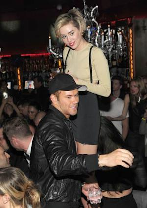 Miley Cyrus and Kellan Lutz in Las Vegas on December 27, 2013 -- Getty Images