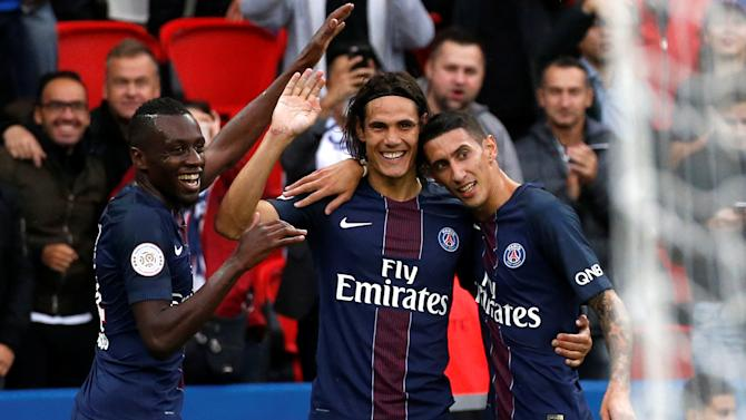 Paris Saint-Germain's Edison Cavani celebrates with team-mates after he scored against Girondins de Bordeaux
