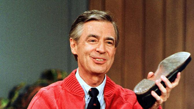 """FILE - This June 28, 1989 file photo shows Fred Rogers as he rehearses the opening of his PBS show """"Mister Rogers' Neighborhood"""" during a taping in Pittsburgh. Rogers, the late host of """"Mister Rogers Neighborhood,"""" is featured in a PBS Digital Studios video mashup that celebrates the power of imagination. The piece turns clips from Rogers show into a sweetly inspiring music video, """"Garden of Your Mind."""" A PBS spokesman says the video posted Friday on PBS Digital Studios' YouTube channel is intended to get people talking about public television. More such tribute mashups are planned, spokesman Kevin Dando said. (AP Photo/Gene J. Puskar, File)"""
