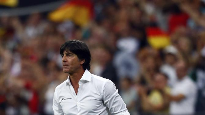 Germany's coach Joachim Loew gestures during their 2014 World Cup qualifying soccer match against Austria in Munich