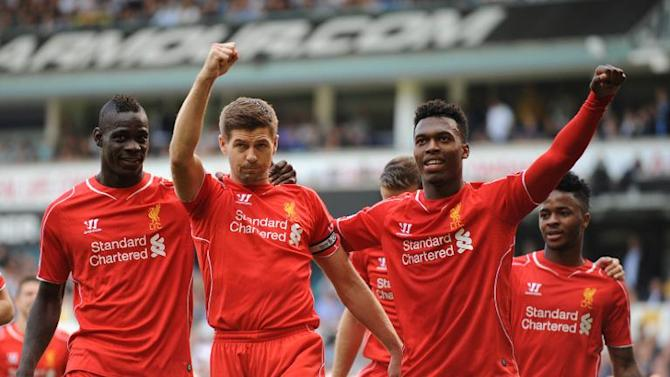 Liverpool midfielder Steven Gerrard (R) celebrates scoring a penalty against Tottenham Hotspur with striker Mario Balotelli (L), at London's White Hart Lane on August 31, 2014