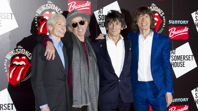 FILE - A Thursday, July 12, 2012 photo from files showing, from left, Charlie Watts, Keith Richards, Ronnie Wood and Mick Jagger, from the British Rock band, The Rolling Stones, as they arrive at a central London venue, to mark the 50th anniversary of the Rolling Stones first performance. The Rolling Stones will be taking the stage again this summer at one of Britain's leading music festivals. The Stones' appearance at the 2013 Glastonbury Festival — set to take place from June 28 to June 30 — was revealed Wednesday, March 27, 2013,  in a line-up posted on the festival's website. (AP Photo/Jonathan Short, File)