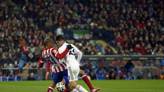 Atletico Madrid's Filho fights for the ball with Real Madrid's Isco during their Spanish King's Cup semi-final second leg soccer match in Madrid