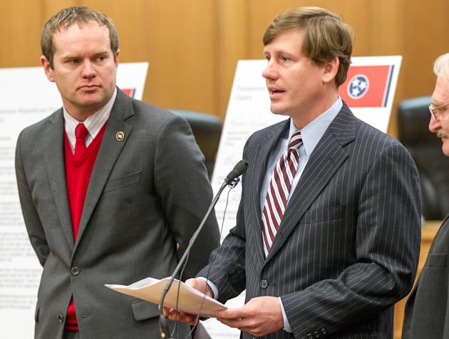 In this Feb. 2, 2015, photo, Sen. Brian Kelsey, R-Germantown, speaks at a press conference at the legislative office complex in Nashville, Tenn., while Rep. Jeremy Durham, R-Franklin, left, listens. K