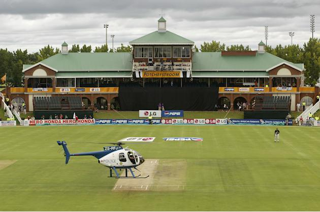 A police helicopter attempts to dry the pitch