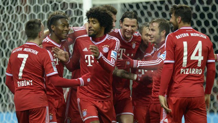 Bayern Munich's players celebrate during their German Bundesliga first division soccer match against Werder Bremen in Bremen