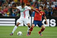 Portuguese midfielder Nani (L) vies with Spanish defender Jordi Alba during the Euro 2012 football championships semi-final match Portugal vs. Spain at the Donbass Arena in Donetsk. Barcelona struck a deal Thursday to sign Valencia and Spain left-back Alba for 14 million euros ($17.5 million) on a five-year contract, the Catalan club said