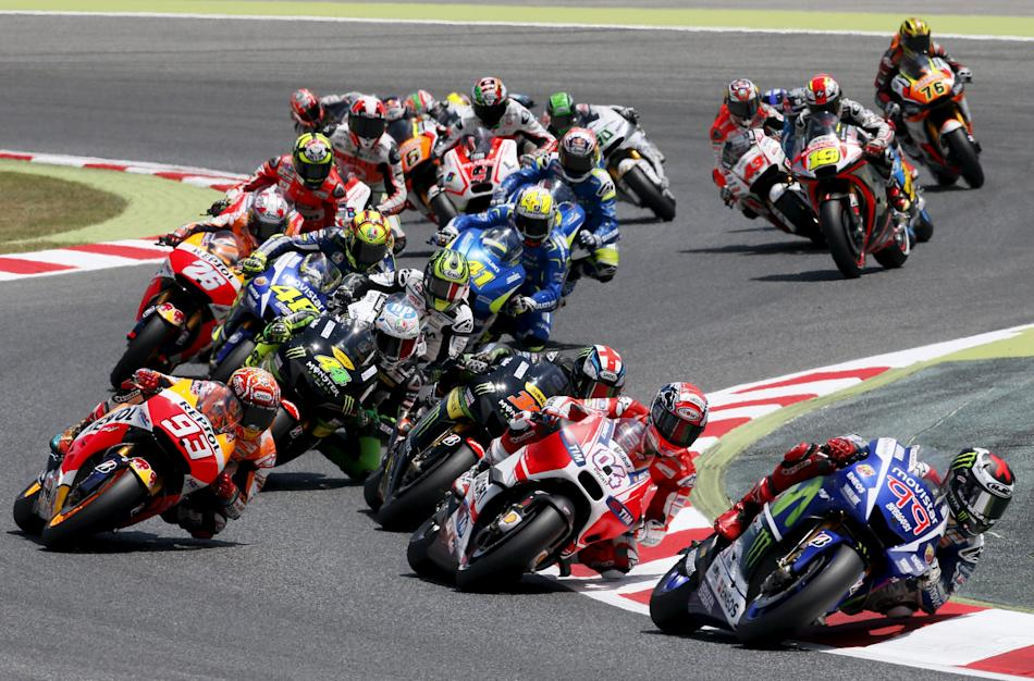 Yamaha MotoGP rider Jorge Lorenzo from Spain leads the pack during the first lap of the Catalunya Grand Prix in Montmelo
