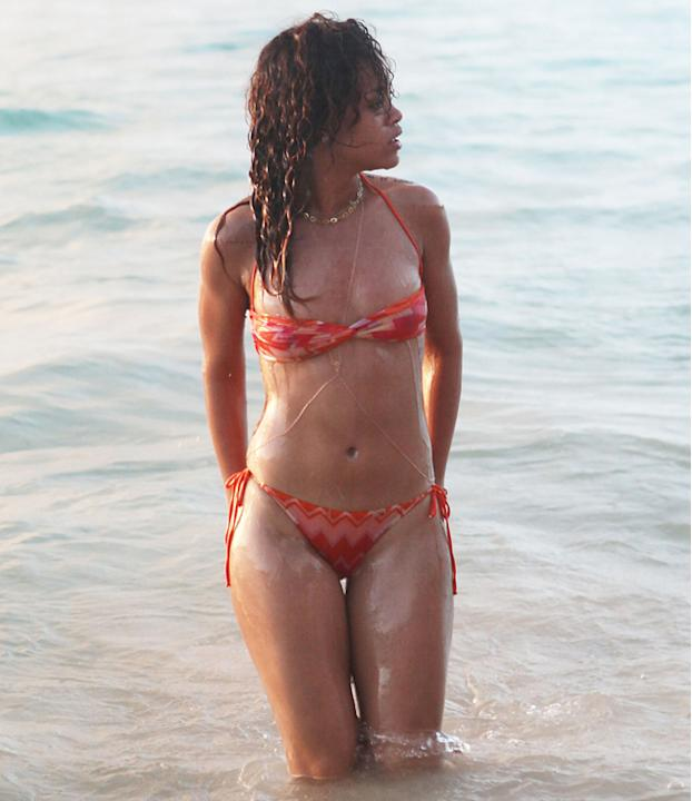 Celebrities in bikinis: Barbadian babe Rihanna took to the waves at Christmas in a tiny two piece.