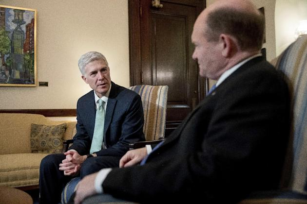 Supreme Court Justice nominee Neil Gorsuch, left, meets with Sen. Chris Coons, D-Del. on Capitol Hill in Washington, Tuesday, Feb. 14, 2017. (AP Photo/Andrew Harnik)