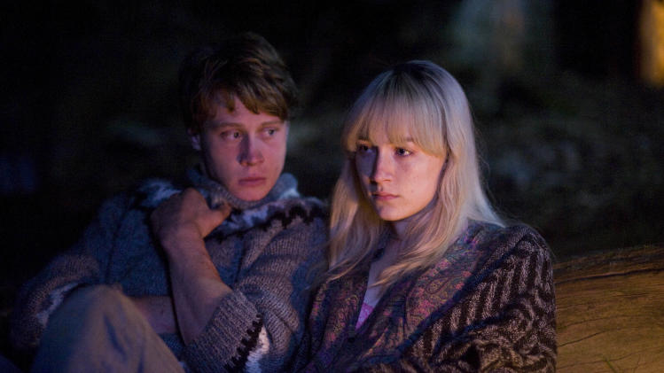"This image released by Magnolia Pictures shows George MacKay, left, and Saoirse Ronan in a scene from ""How I Live Now."" (AP Photo/Magnolia Pictures)"
