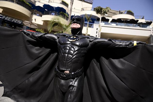 IMAGE DISTRIBUTED FOR WARNER BROS. CONSUMER PRODUCTS - A fan poses dressed as a DC Comics Super Hero at the DC Comics Super Hero World Record Event to set a Guinness World Record at the Hollywood & Hi