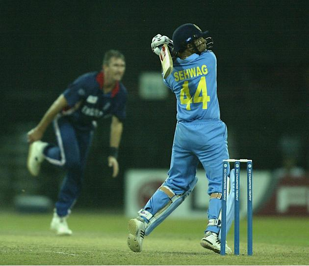 Virendra Sehwag of India scores off the bowling of Andy Caddick of England