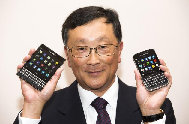 REFILE - CORRECTING LOCATION BlackBerry Chief Executive John Chen holds up the unreleased Blackberry Passport and Blackberry Classic (R) devices during the company's annual general meeting for shareholders in Waterloo June 19, 2014. BlackBerry Ltd posted a narrower-than-expected loss as the troubled smartphone maker's turnaround efforts started to pay off, raising hopes Chen can deliver on a pledge to return the company to steady profits. REUTERS/Mark Blinch (CANADA - Tags: BUSINESS TELECOMS)