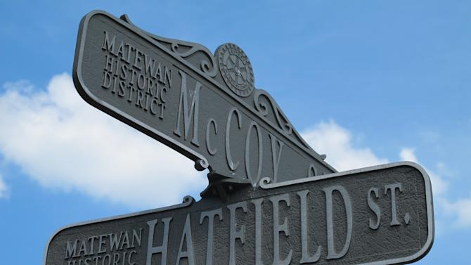 A Saturday, June 9, 2012 file photo shows a street sign in Matewan, W.Va., that bears the names of the two families that once waged the country's most famous feud in this Appalachian region. Artifacts unearthed last year during filming of a new National Geographic Channel show appear to pinpoint the location of an 1888 ambush on Randolph McCoy's cabin by the Hatfield clan in the woods of eastern Kentucky. Excavators found bullets believed to have been fired by the McCoys in self-defense, along with fragments of windows and ceramic from the family's cabin. Property owner Bob Scott, a Hatfield descendant, plans to capitalize on the historic 70-acre site in eastern Pike County near the West Virginia line. The options include a housing development featuring horseback and ATV trails, he said. (AP Photo/Bruce Schreiner, File)