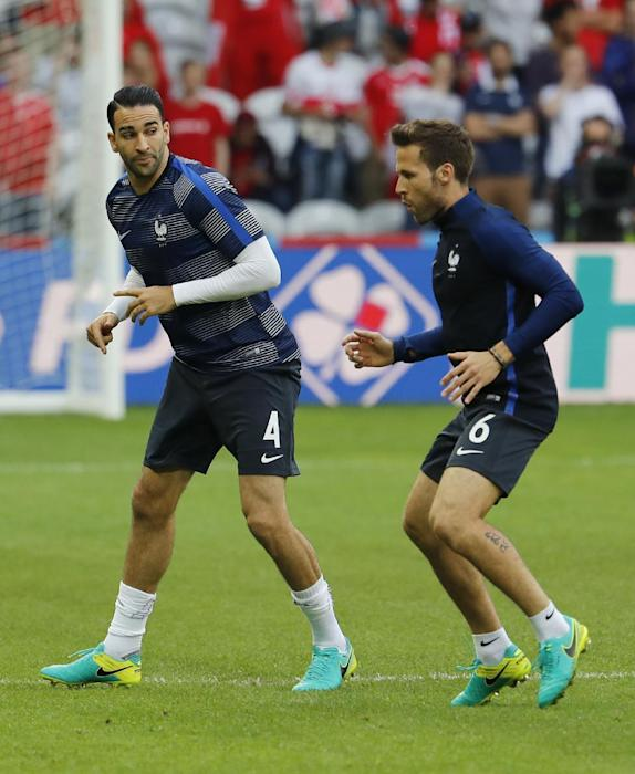 France's Adil Rami (L) and Yohan Cabaye warm up before the game