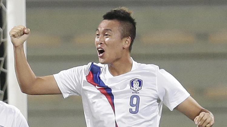 In this Nov. 19, 2013, file photo, South Korea's Shinwook Kim, celebrates scoring the opening goal against Russia during the international friendly soccer match between Russia and South Korea, in Dubai, United Arab Emirates