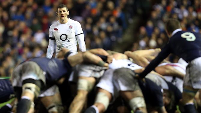 England's Jonny May awaits the ball being passed from a scrum during their Six Nations rugby union international match against Scotland'at Murrayfield, Edinburgh, Scotland, Saturday Feb. 8, 2014. (AP Photo/Scott Heppell)