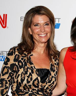 "FILE - This Sept. 27, 2011 file photo originally released by Starpix shows CNN anchor Carol Costello, at a party launching her colleague, Erin Burnett's show ""Erin Burnett Outfront,"" in New York. Atlanta police are investigating after a CNN anchor reported that her iPhone was snatched from her hand as she strolled down a street on Thursday, May 2, 2013.  Police tell WSB-TV that Carol Costello was talking on the phone while walking when two teenagers ran up from behind and grabbed the phone.  Costello said in a post on her Facebook page that she struggled with one suspect as she tried to keep her phone, but he pulled out a chunk of her hair and she let go. (AP Photo/Starpix, Amanda Schwab, file)"