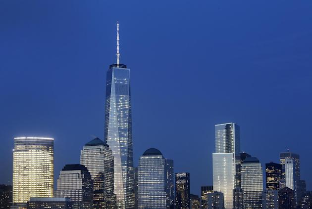 Goldman Sachs headquarters, left, One World Trade Center, center, and 4 World Trade Center, right, stand above the lower Manhattan skyline, Wednesday, April 2, 2014 in New York. (AP Photo/Mark Lenniha