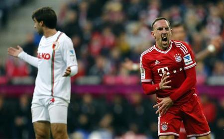 Munich's Ribery reacts after he was challenged by FC Augsburg's Moravek during their German first division Bundesliga soccer match in Munich
