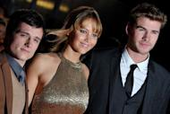 "L-R: Josh Hutcherson, Jennifer Lawrence and Liam Hemsworth attend the European Premiere of 'The Hunger Games' in east London on March 14. Teen movie phenomenon ""The Hunger Games"" is vying to set a US box office record this weekend, after advance sales already put it in the top three, according to a major ticket seller Thursday"