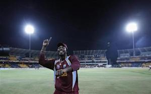West Indies' Chris Gayle celebrates after winning the World Twenty20 final cricket match against Sri Lanka in Colombo October 7, 2012. REUTERS/Dinuka Liyanawatte/Files