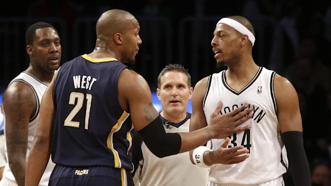 Indiana Pacers' David West, left, talks with Brooklyn Nets' Paul Pierce after Pierce was called for a flagrant foul during the second half of an NBA basketball game Monday, Dec. 23, 2013, in New York. The Pacers defeated the Nets 103-86