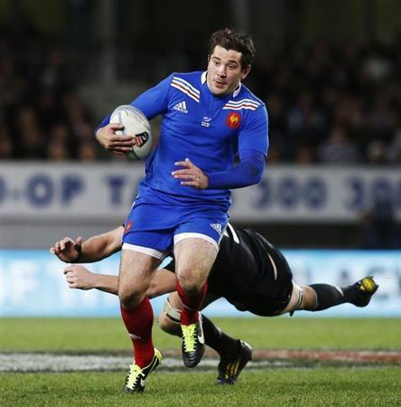 Florian Fritz of France evades Brodie Retallick of New Zealand's All Blacks during their rugby union test match in Auckland