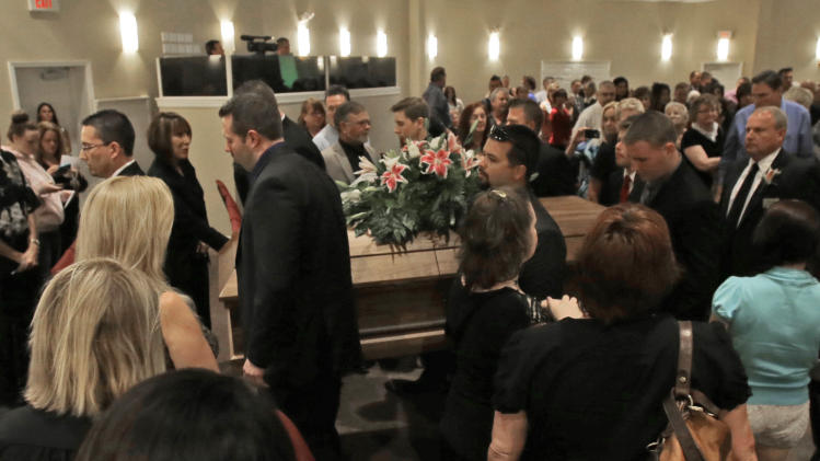 Pall bearers carry the casket of country music star Mindy McCready after a funeral ceremony at the Crossroads Baptist Church in Fort Myers, Fla., Tuesday, Feb. 26, 2013.  McCready committed suicide Feb. 17 at her home in Arkansas, days after leaving a court-ordered substance abuse program. (AP Photo/Alan Diaz)