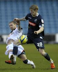 Millwall's striker Andy Keogh (R) clashes with Bolton Wanderers' defender Gretar Rafn Steinsson during the English FA Cup 5th Round football match at The Den in South London