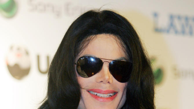 FILE - In this May 27, 2006 file photo, Michael Jackson smiles during a press conference of the MTV Video Music Awards Japan 2006 in Tokyo. The U.S. entertainer was awarded a Legend Award at the ceremony. Jurors hearing a civil case in Los Angeles filed by Jackson's mother, Katherine Jackson, have heard numerous stories about the entertainer's devotion to his children as expressed through extravagant birthday parties and secret family outings. The tender moments have been described throughout the trial, which concluded its eighth week on Friday, June 21, 2013. (AP Photo/Koji Sasahara, File)