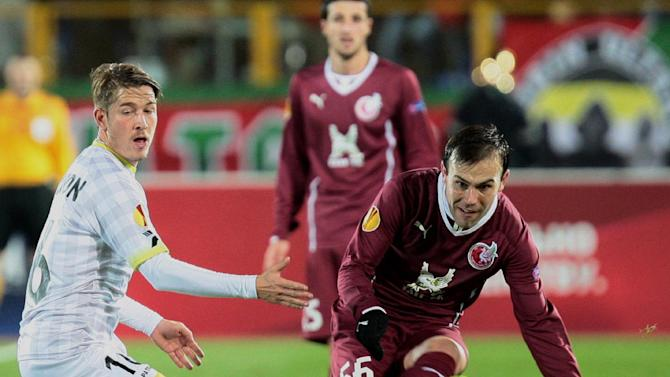 Rubin Kazan's Bebras Natcho, right, kicks the ball as Zulte Waregem's Olafur Skulason looks on during their Europa League Group D soccer match in Kazan, Russia, Thursday, Oct. 3, 2013