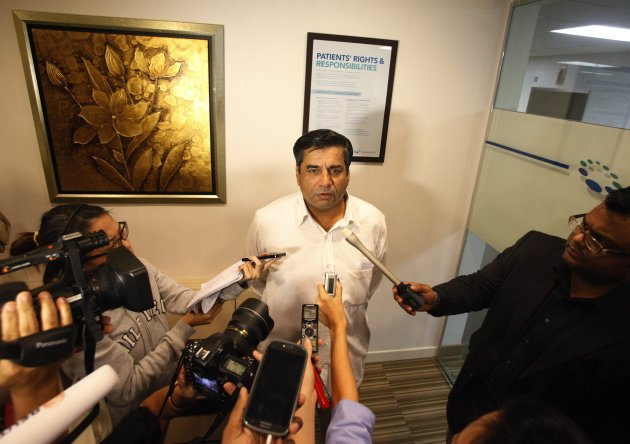 Indian High Commissioner to Singapore T.C.A. Raghavan addresses the media at Mount Elizabeth Hospital. (Reuters photo)