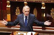 """French Prime Minister Jean-Marc Ayrault addresses Members of Parliament at the National Assembly in Paris. Ayrault said that between 2007 and 2011, France's debt grew by 600 billion euros """"to nearly 1,800 billion euros today, or 90 percent of the wealth produced annually in France."""""""