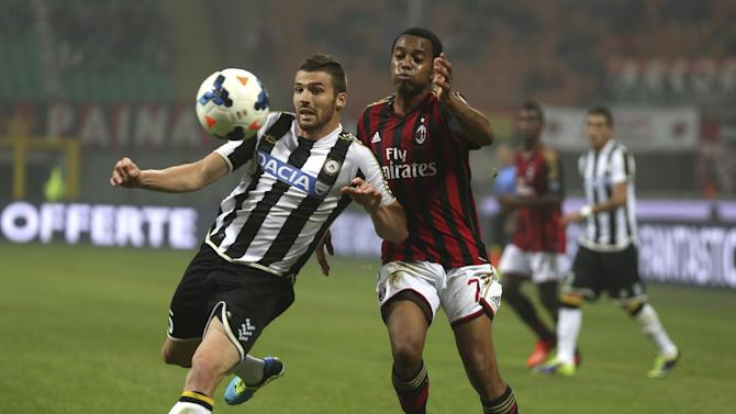 Udinese defender Thomas Heurtaux, left, and AC Milan's Robinho vie for the ball during a Serie A soccer match between AC Milan and Udinese, at the San Siro stadium in Milan, Italy, Saturday, Oct. 19, 2013