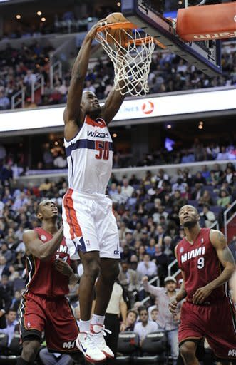 Wizards stun Heat 105-101 for 2nd win of season