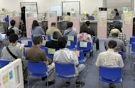 Job seekers await for an interview at the employment exchange office in Tokyo in 2010. Japan's unemployment rate inched up to 4.6 percent in January from a revised 4.5 percent in the previous month, the government said on Friday