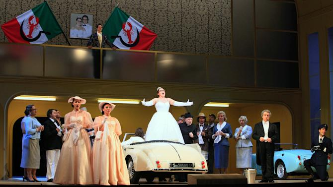 "FILE - In this Jan. 22, 2013 file photo singers perform during a dress rehearsal for the opera ""La Cenerentola"" by Gioachino Rossini, at the state opera in Vienna, Austria. There is no pumpkin-turned-coach on the stage, no glass slipper, no fairy godmother, and the action takes place in an imaginary Italian duchy in the 1950s. But Gioachino Rossini's take on Cinderella remains utterly magical in the new version being put on by the Vienna State Opera with the premiere on Sunday Jan. 27, 2013. (AP Photo/dapd, Lilli Strauss)"