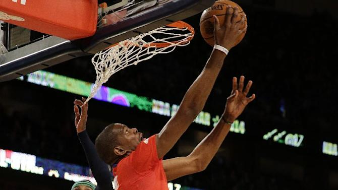 West Team's Kevin Durant, of the Oklahoma City Thunder (35) goes to the hoop against Team east during the NBA All Star basketball game, Sunday, Feb. 16, 2014, in New Orleans