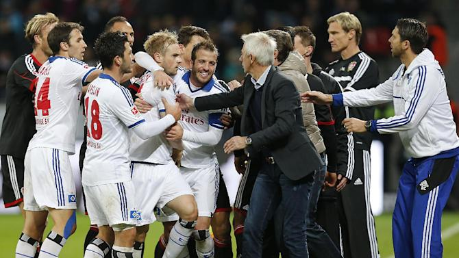 Players of both teams argue during the German first division Bundesliga soccer match between Bayer Leverkusen and Hamburg SV in Leverkusen, Germany, Saturday, Nov. 9, 2013