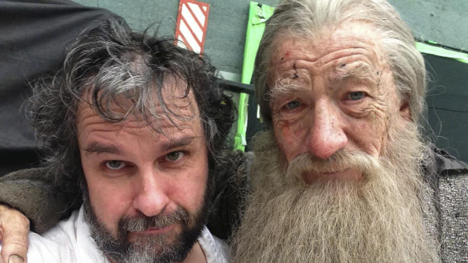 "This Friday, July 26, 2013 photo taken and released by Peter Jackson, actor Ian Murray McKellen, right, as Gandalf poses with Jackson on the final day of filming of The Hobbit in Wellington, New Zealand. Jackson has wrapped up filming ""The Hobbit"" trilogy and shared pictures of his last day on the set with his Facebook fans. The New Zealand filmmaker provided a steady stream of updates and photos from the set of the final film, ""The Hobbit: There And Back Again,"" on Friday, July 26. The second film, ""The Hobbit: The Desolation of Smaug,"" will be released in December, and the finale appears in 2014. (AP Photo/Peter Jackson) MANDATORY CREDIT(AP Photo/Peter Jackson)"