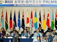 Japanese Prime Minister Yoshihiko Noda (C) gives the opening speech of the 6th Pacific Islands Leaders Meeting in Nago city, Japan's southern Okinawa prefecture, on May 26. Japan pledged aid worth up to half a billion dollars to Pacific island nations Saturday at a summit stressing the importance of maritime law in a region warily eyeing China's growing might at sea