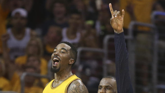 Cleveland Cavaliers guard J.R. Smith (5) and forward LeBron James react late in the second half of Game 4 of the NBA basketball Eastern Conference finals against the Atlanta Hawks, Tuesday, May 26, 2015, in Cleveland.  The Cavaliers won 118-88. (AP Photo/Ron Schwane)