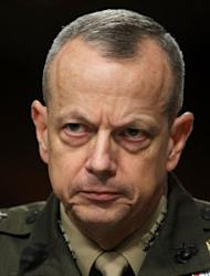 "US General John Allen -- who is in charge of NATO's 130,000 troops in Afghanistan -- testifies before a Senate Committee in March 2012. Allen has offered to help local security forces track and capture the men involved in what he called ""an atrocity of unspeakable cruelty"". A manhunt is under way for Taliban militants who publicly executed a woman accused of adultery"
