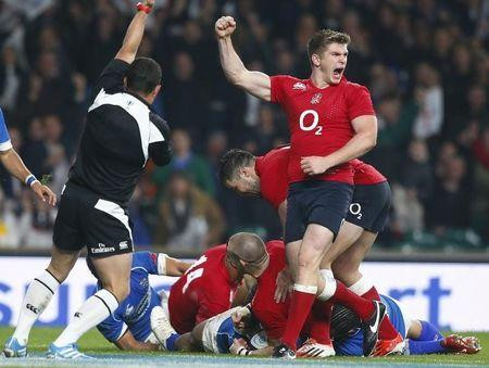 Farrell celebrates as Brown of England scores a try against Samoa during their international rugby test match in London