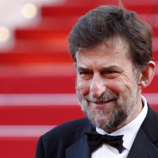 "In this photo taken Saturday, May 16, 2015, director Nanni Moretti leaves following the screening of the film Mia Madre (My Mother) at the 68th international film festival, Cannes, southern France. Moretti is a Cannes mainstay, who has brought more than half a dozen films to the festival. He won the Palme d'Or in 2001 for ""The Son's Room,"" about a family devastated by the death of a teenage son. His film ""Mia Madre"" is competing for the Palme d'Or. (AP Photo/Lionel Cironneau)"