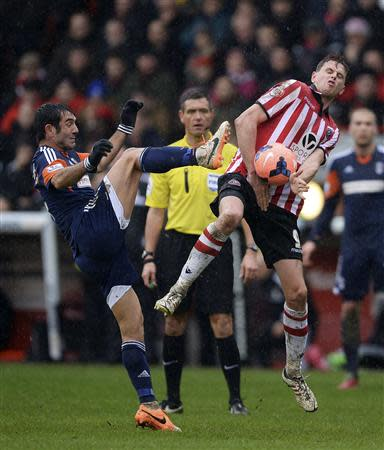 Sheffield United's Porter challenges Fulham's Karagounis during their FA Cup soccer match at Bramhall Lane in Sheffield
