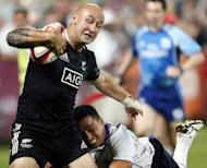 New Zealand's Dj J Forbes (L) shrugs off the tackle of Samoa's Reupena Levasa during their IRB Sevens World Series match in Dubai on December 1. Samoa won 26-15 but the Kiwis will be looking for a return to form when the South African round takes place in Port Elizabeth this weekend
